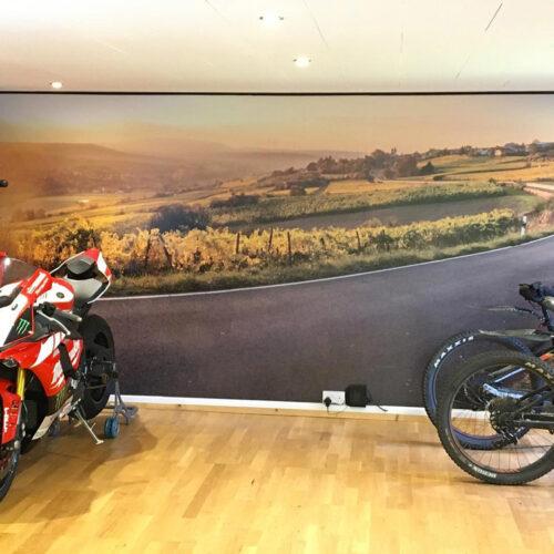A landscape image wall wrap applied to a bike showroom wall