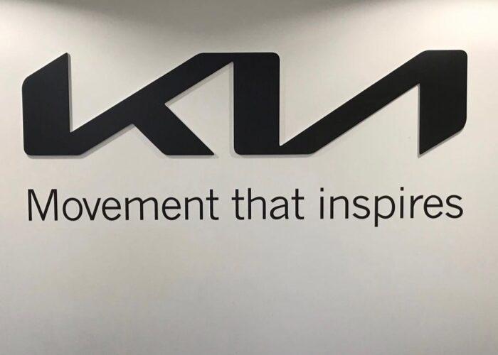 Branding an office wall with the Kia logo