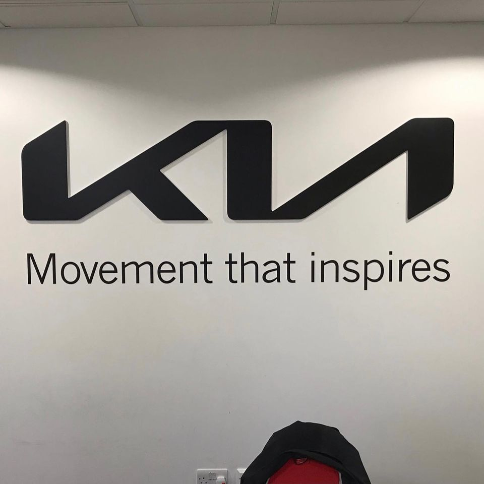 Branding an office wall with the Kia logo